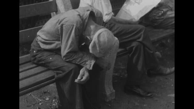 president franklin roosevelt speaks / man sits on park bench, mends piece of clothing with needle and thread during the great depression / montage... - newsreel stock videos & royalty-free footage