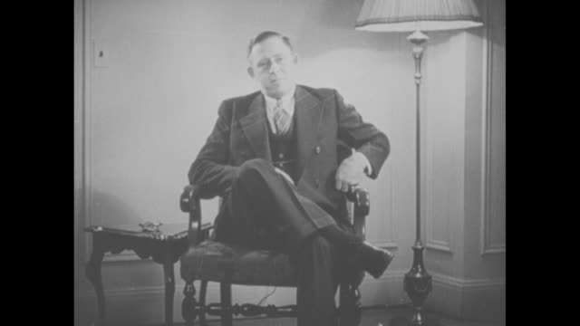 president franklin roosevelt's personal bodyguard gus gennerich sitting in chair, takes cigarette from pack and puts it in his mouth / roosevelt and... - chauffeur stock videos & royalty-free footage