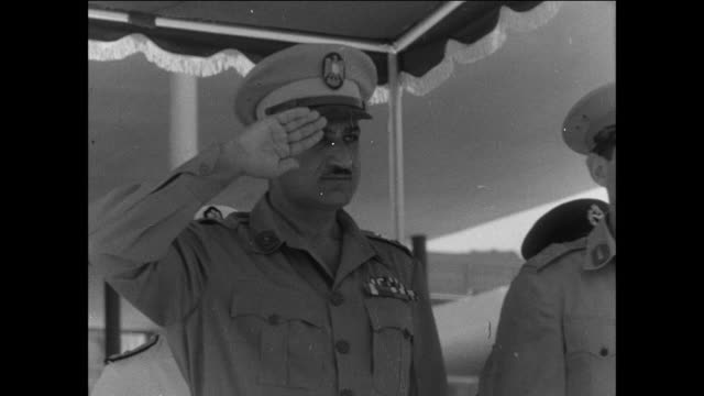 president gamal nasser presides over a military parade marching through the streets of cairo / egypt - 1956 stock videos & royalty-free footage