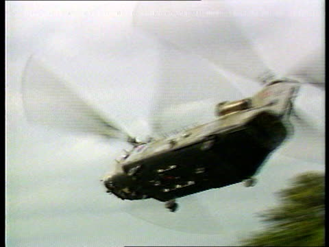 president george bush at nato summit; itn lib ext england: raf lakeheath: usaf f-111 jet edges out of hangar salisbury plain av raf boeing vertol... - 西ドイツ点の映像素材/bロール