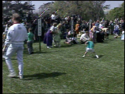 / president george bush blowing whistle to start easter egg roll on the white house lawn / children rolling eggs / easter bunny costumes easter egg... - osterhase stock-videos und b-roll-filmmaterial