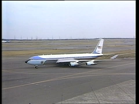 President George Bush in Japan prior to Emperor Hirohito funeral JAPAN Tokyo Tokyo Airport Presidential aircraft taxiing seen over heads of crowd TMS...