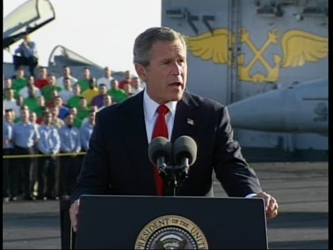 """president george bush is on the deck of the uss abraham lincoln to make a controversial speech known as """"2003 mission accomplished speech."""" and state... - iraq video stock e b–roll"""