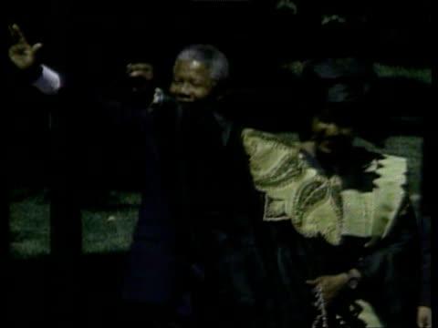 president george bush senior and wife barbara walk across lawn with nelson and winnie mandela washington dc 25 jun 90 - nelson mandela stock videos and b-roll footage