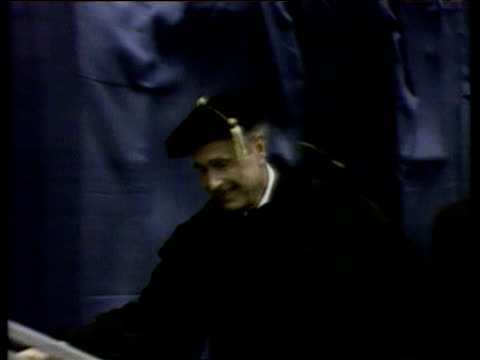 president george bush senior walks onto platform of graduation ceremony wearing cap and gown texas 11 may 90 - graduation gown stock videos and b-roll footage
