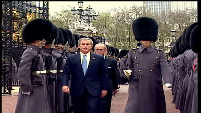 president george bush state visit; england: london: buckingham palace: ext tcms prince philip and president george w bush along inspecting guard of... - laura bush stock videos & royalty-free footage