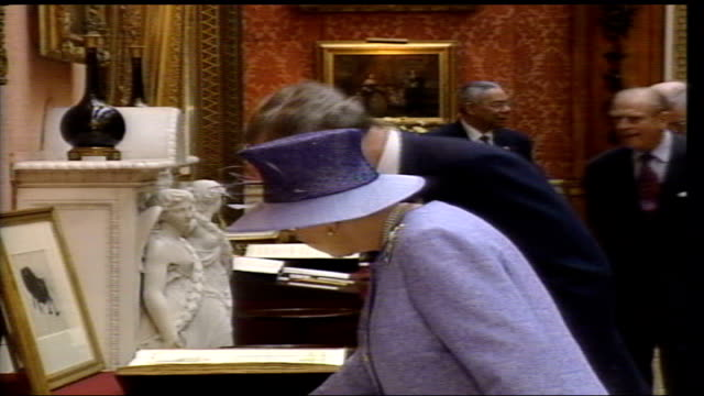 royals and george bush viewing exhibition inside buckingham palace england london buckingham palace queen elizabeth ii and prince philip and us... - fade out stock videos & royalty-free footage