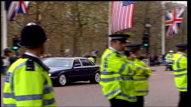protest england london ext ls police officers lining the mall as cavalcade of cars and armoured limousine carrying president george w bush along and... - limousine stock-videos und b-roll-filmmaterial