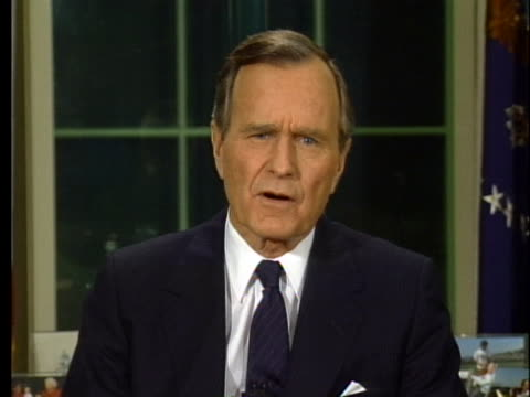 vídeos de stock, filmes e b-roll de us president george h w bush addresses the nation about the combined nations moving against iraq during desert storm from the oval office - (war or terrorism or election or government or illness or news event or speech or politics or politician or conflict or military or extreme weather or business or economy) and not usa