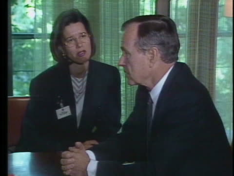 us president george h w bush and west german chancellor helmut kohl meet around a conference table in west berlin - (war or terrorism or election or government or illness or news event or speech or politics or politician or conflict or military or extreme weather or business or economy) and not usa stock-videos und b-roll-filmmaterial
