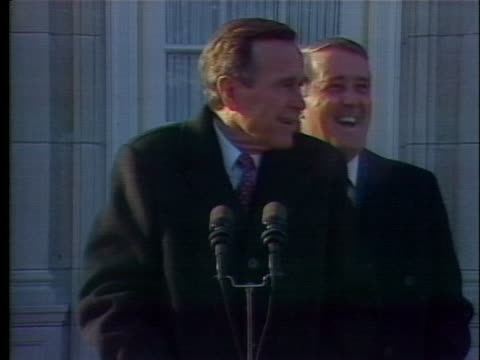 president george h.w. bush jokes in french with canadian prime minister brian mulroney about the cold weather in canada. - environment or natural disaster or climate change or earthquake or hurricane or extreme weather or oil spill or volcano or tornado or flooding stock videos & royalty-free footage