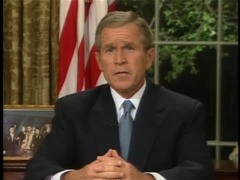 vídeos de stock e filmes b-roll de president george w bush addresses the nation from the oval office on september 11, 2001. - 2001