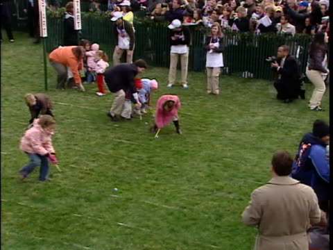 """president george w. bush and first lady laura bush blow a whistle to start the easter egg roll. first lady laura bush say, """"when you hear the whistle... - laura bush stock videos & royalty-free footage"""
