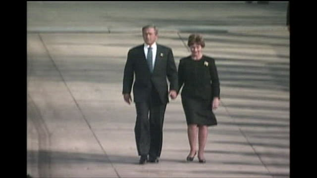 president george w. bush and first lady laura bush enter ground zero on the one year anniversary of the 9/11 attacks. - september 11 2001 attacks stock videos & royalty-free footage