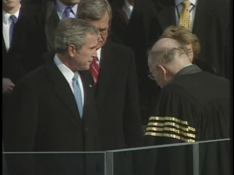 president george w. bush and first lady laura bush join chief justice william rehnquist at the podium for the inauguration ceremony in 2005. - laura bush stock videos & royalty-free footage