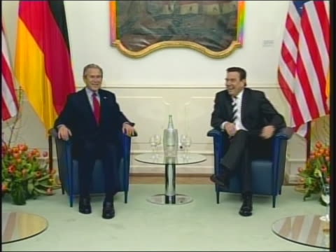president george w. bush and germany chancellor gerhard schroeder taking their seats for a conference at the electoral palace in mainz, germany. at... - 大量破壊兵器点の映像素材/bロール