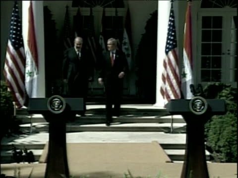 US President George W Bush and Interim Iraqi Prime Minister Iyad Allawi walk towards podiums outside White House to deliver speech Washington DC Sep...