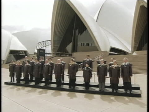 president george w. bush and other members of the asia-pacific economic cooperation stand in front of the sydney opera house in australia. - (war or terrorism or election or government or illness or news event or speech or politics or politician or conflict or military or extreme weather or business or economy) and not usa stock videos & royalty-free footage