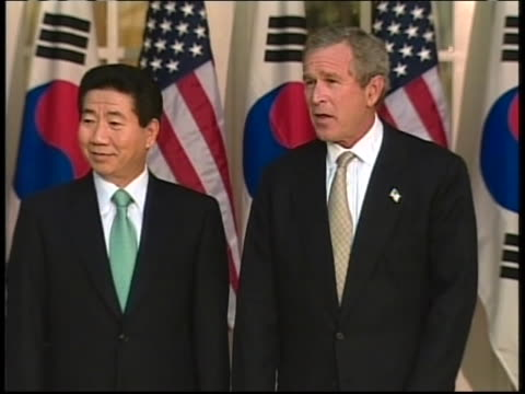 president george w. bush and south korean president roh moo-hyun pose for a photo-op in the white house rose garden. - roh moo hyun stock videos & royalty-free footage