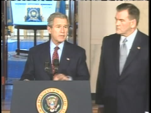 president george w. bush and vice president dick cheney watch as united states secretary of homeland security, tom ridge is sworn in. - dick cheney stock videos & royalty-free footage