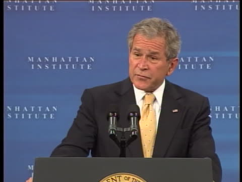 president george w bush discusses the effects of the 2008 financial crisis on average people businesses and developing nations during a speech at the... - business or economy or employment and labor or financial market or finance or agriculture stock-videos und b-roll-filmmaterial