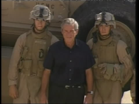 president george w. bush greets american soldiers during a surprise visit to iraq. - demokrati bildbanksvideor och videomaterial från bakom kulisserna