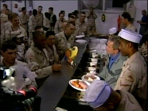 president george w bush helps to serve thanksgiving dinner to us troops iraq nov 03 - bush stock videos & royalty-free footage