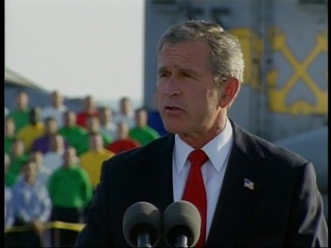 president george w. bush on the uss abraham lincoln, thanks the citizens iraq for joining them in the liberation of their country and says america is... - iraq video stock e b–roll