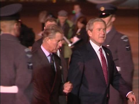 us president george w bush talks to the prince of wales as he walks down red carpet through raf guard of honour at heathrow at the start of state... - guard of honour stock videos and b-roll footage