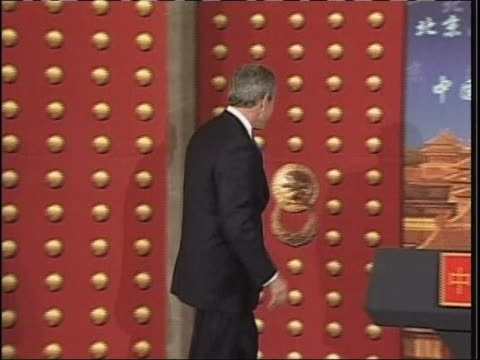 president george w. bush tries to walk through a fake door while on television in japan. - blooper film clip stock videos & royalty-free footage