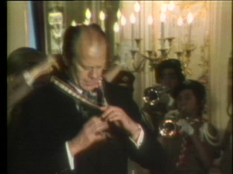 president gerald ford receives the golden pheasant award from a group of japanese boy scouts during his trip to japan in 1974. - scout association stock videos & royalty-free footage