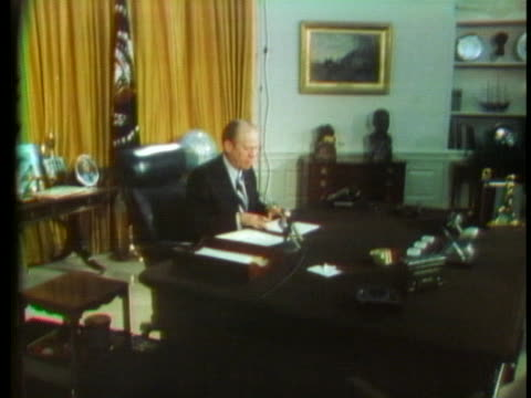 president gerald ford sits behind his desk in the oval office, in preparation for a presidential address. - president stock videos & royalty-free footage