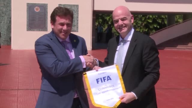 vídeos de stock, filmes e b-roll de fifa president gianni infantino begins his first south american tour in paraguay a region that was highly affected by the corruption scandal of 2015 - gianni infantino