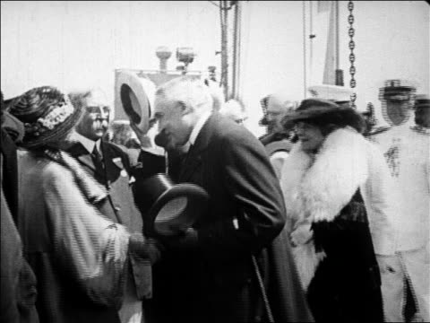 vídeos de stock, filmes e b-roll de president harding shaking hands with senator cabot women / plymouth mass / newsreel - 1923