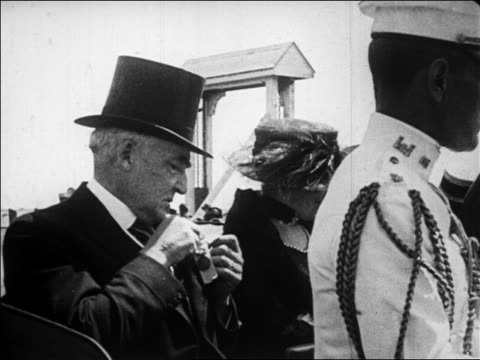 president harding sitting in car with wife putting pin on lapel smiling / newsreel - 1923 stock videos & royalty-free footage