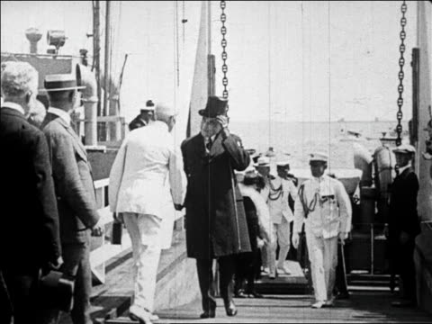 president harding walking up gangway shaking hands with politicians / plymouth / newsreel - 1923 stock videos & royalty-free footage