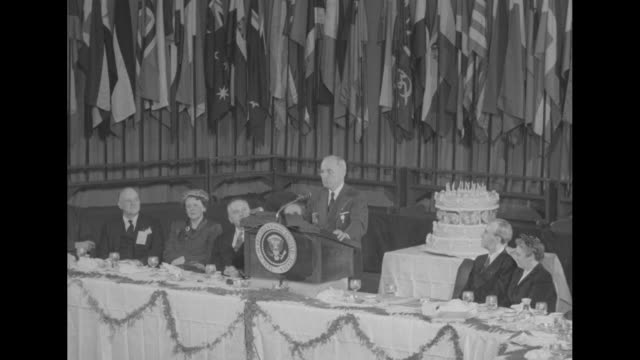 ms president harry s truman appearing at the convention of the columbia scholastic press association speaks from lectern at table with world flags... - waldorf astoria new york stock videos & royalty-free footage