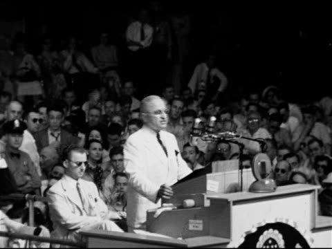 vídeos de stock, filmes e b-roll de president harry s truman behind podium saying america has been turned from isolationismmust accept leadership in international affairsunited nations... - 1948