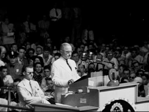 vídeos de stock, filmes e b-roll de president harry s truman behind podium thanking convention for barkley nomination will win make republicans like it victory has become a habit of our... - 1948