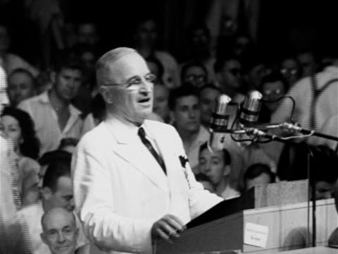 vídeos de stock, filmes e b-roll de president harry s truman behind podium thanking everyone apologizing for mics being high he has to see what he's doing accepting nomination - 1948