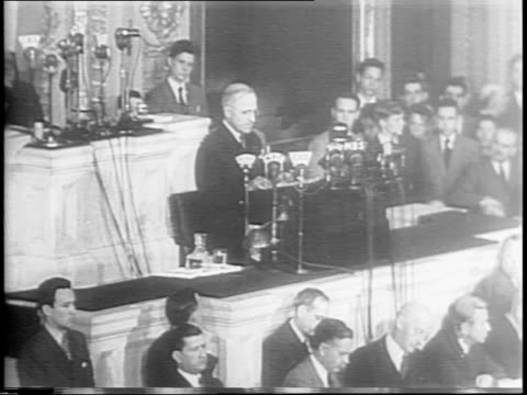 president harry s truman delivers his first congressional address / congress stands and applauds / truman speaks of fdr says us 'must carry on' and... - surrendering stock videos & royalty-free footage