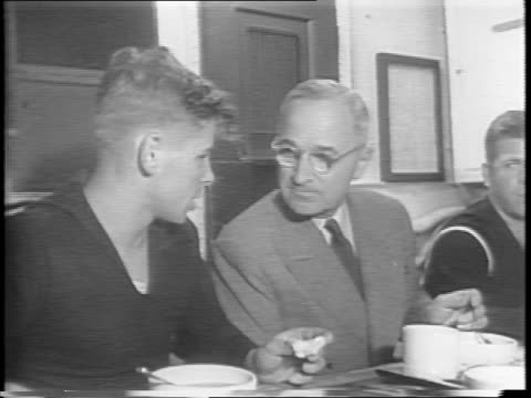 president harry s truman eats in mess hall with navy men / he speaks with soldier seated next to him / truman in an office with james byrnes going... - präsident der usa stock-videos und b-roll-filmmaterial