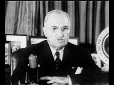 us president harry s truman gives address from the oval office about us involvement in korea / montage ext white house at night with lights shining... - 1951 stock videos & royalty-free footage