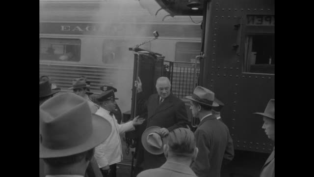 president harry s truman hat in hand steps off rear platform of train car greets porter / on platform surrounded by press he waves hat for photographs - porter stock videos & royalty-free footage