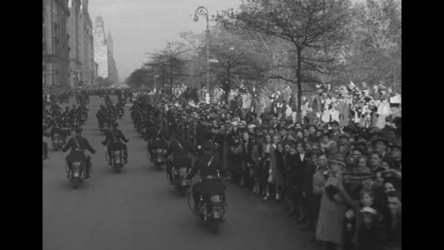 ms president harry s truman limo drives up street past waving crowd with motorcade behind limo and motorcycle policeman with sidecar / from behind... - police line up stock videos and b-roll footage