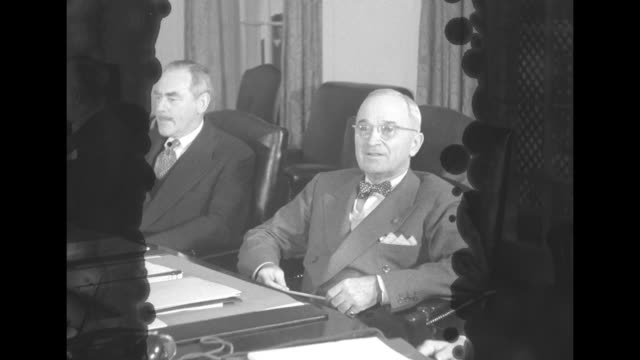 president harry s truman meets with the national security council to the left of truman is secretary of state dean acheson / ws national security... - joint chiefs of staff stock videos and b-roll footage