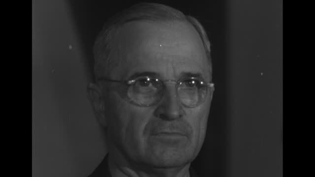 president harry s truman / mws truman standing behind desk with his cabinet, reading japanese surrender from paper in his hand / hull - harry truman stock videos & royalty-free footage