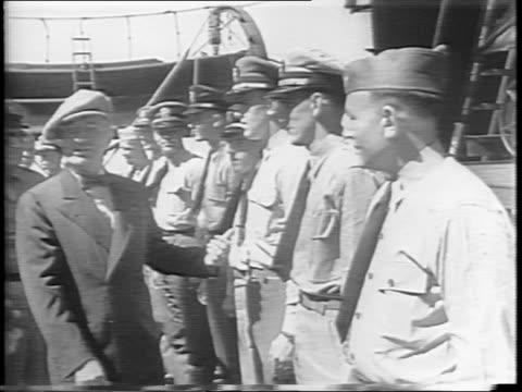 president harry s truman peers over deck / cruiser philadelphia at sea / truman descends stairs and meets navy officers on deck of uss augusta /... - potsdam conference stock videos and b-roll footage