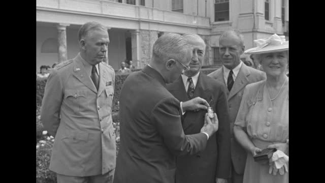 president harry s. truman pins distinguished service medal onto james francis byrnes, us secretary of state, on white house lawn; also pictured are... - pinning stock videos & royalty-free footage