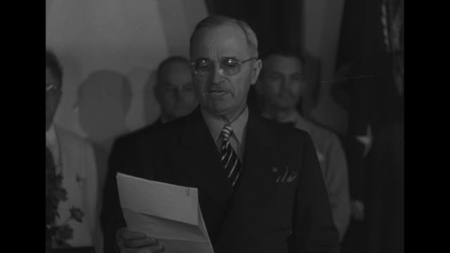 mcu president harry s truman reads report of japanese surrender / cu truman / mls crowd of reporters running out of briefing to file their reports - japanese surrender stock videos and b-roll footage